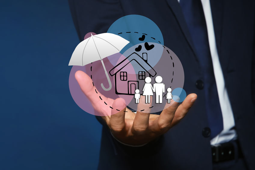 Insurance concept - umbrella demonstrating protection. Man with illustrations on dark background, closeup